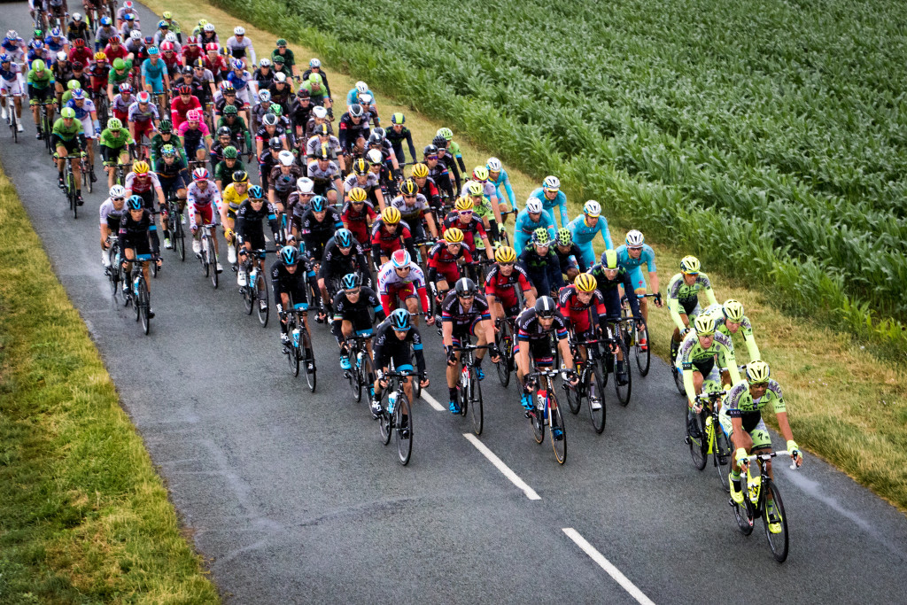 The peloton rolls through Bretincourt 5-wide, still not in a rush to get anywhere.