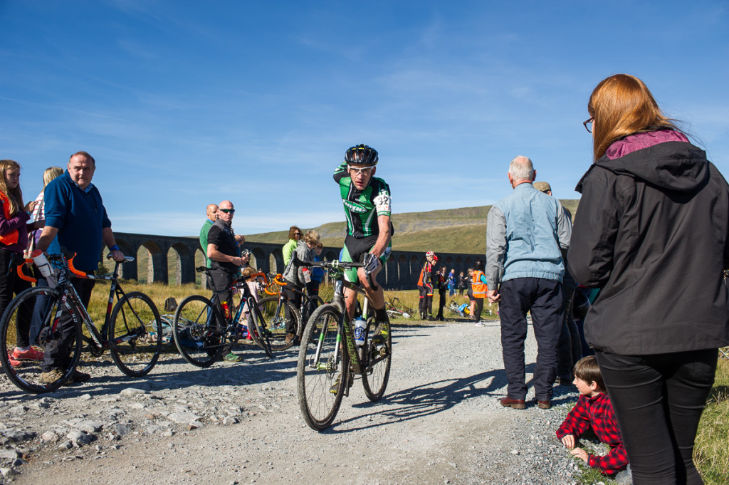 Race winner Paul Oldham passes Ribblehead Viaduct at the bottom of the Whernside descent. © 2015 Jack Chevell