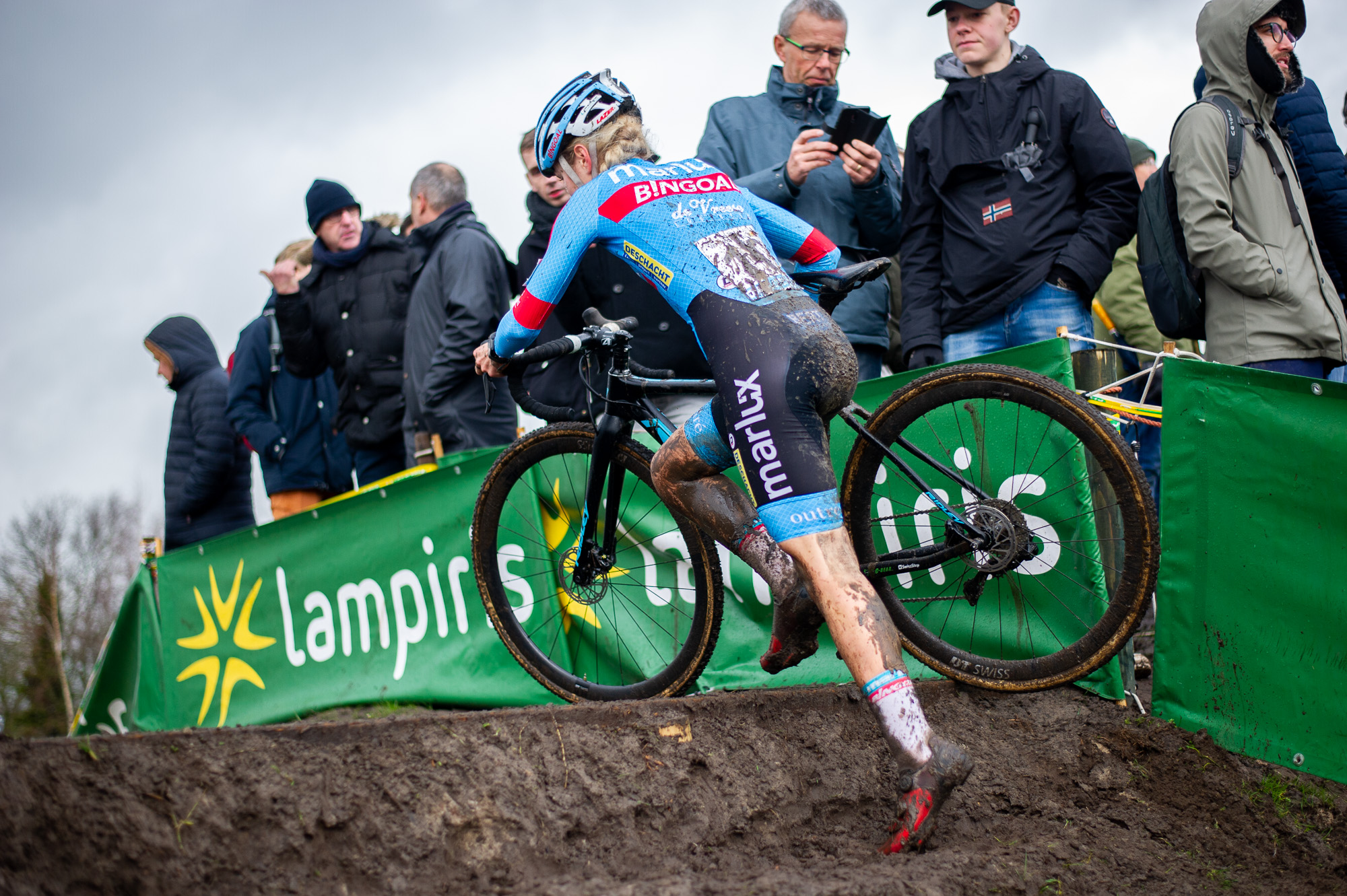 Laura Verdonschot on the muddy steps in Hoogstraten