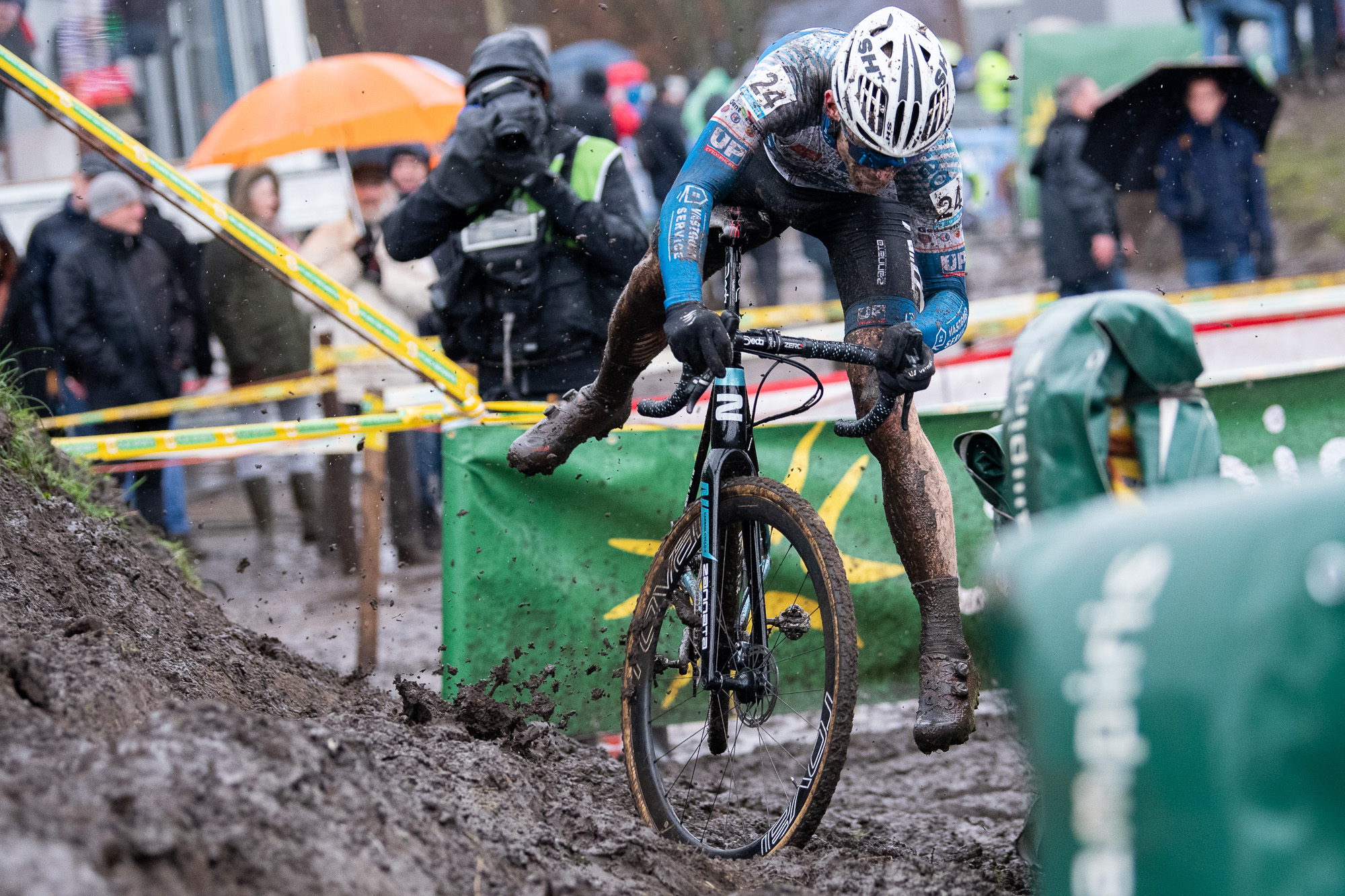 Sieben Wouters falling off his bike entering the off-camber in Hoogstraten