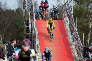 Rebecca Fahringer descends off the tall fly-over at Krawatencross
