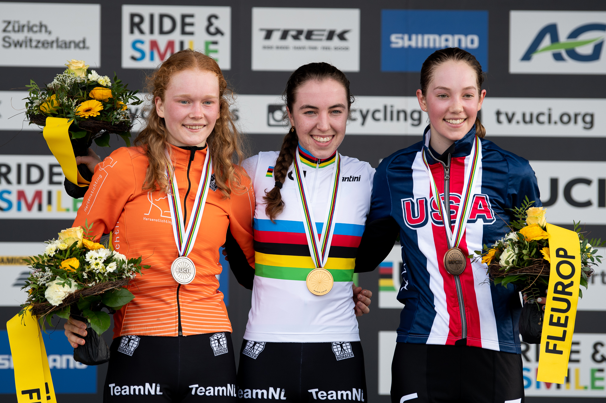 Puck Pieterse, Shirin Van Anrooij and Madigan Munro on the podium at the UCI Cyclocross World Championships