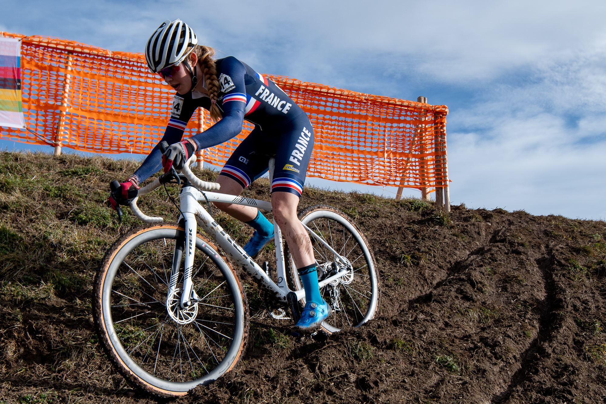 Line Burquier in a rut on an off-camber descent at the UCI Cyclocross World Championships