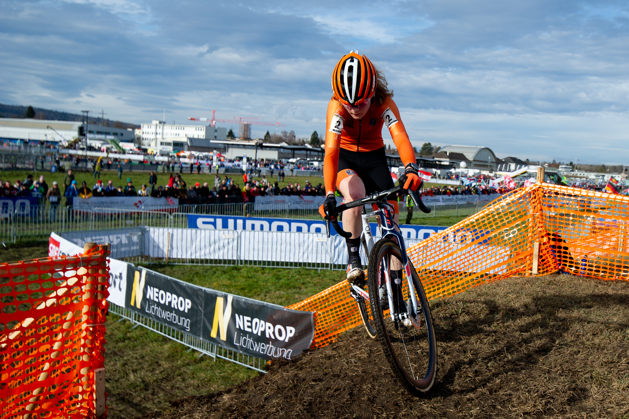 Puck Pieterse crests a berm UCI Cyclocross World Championships